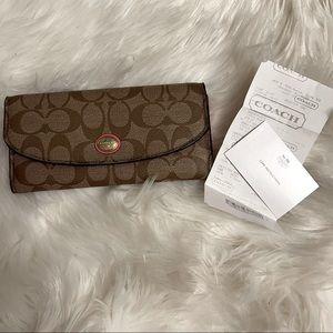 Coach slim signature monogram wallet